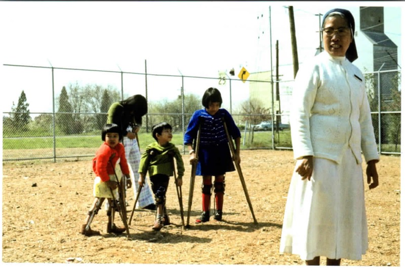 Vietnamese Sister with children on crutches