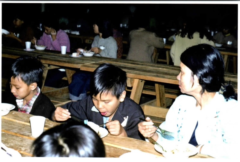 Vietnamese immigrants eating<br />
