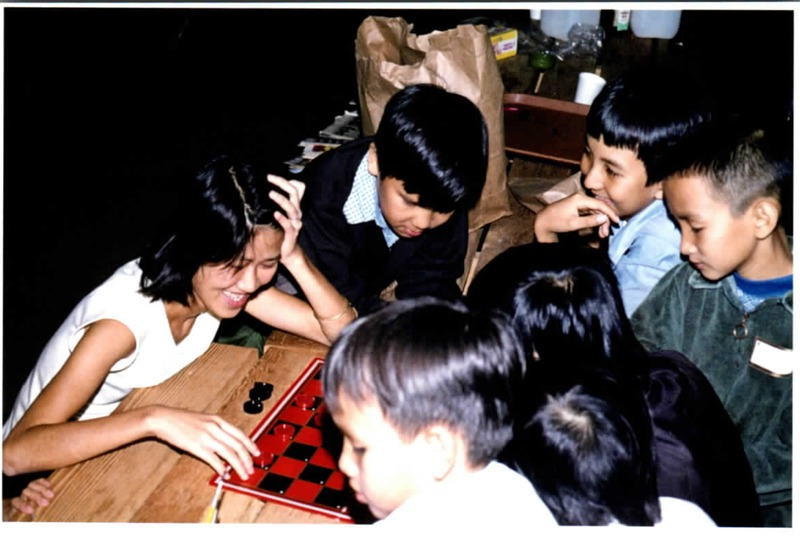 Vietnamese immigrants playing checkers<br />