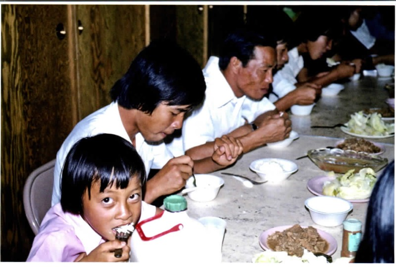 Vietnamese immigrants eating a meal