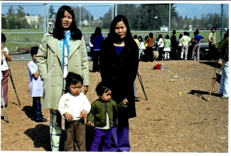 Anna Marie Mai with another Vietnamese woman and two children