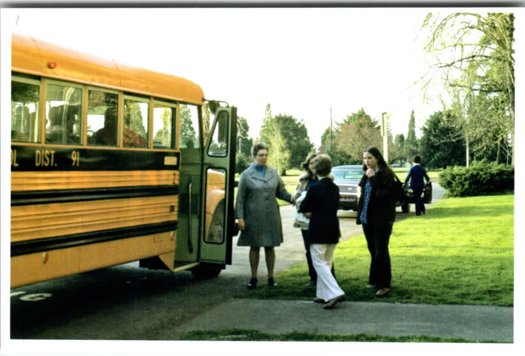 Buses in front of monastery with volunteers and Sr. Antoinette