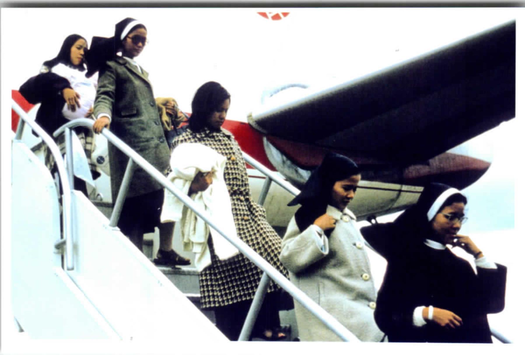 Vietnamese nuns exiting plane