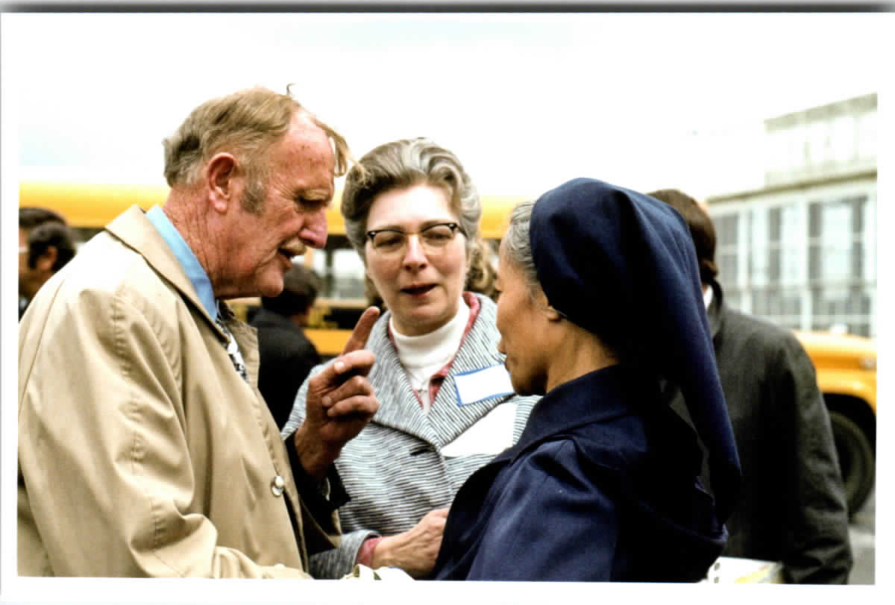 """Colonel Harry Lambert and Sr. Antoinette meeting one of the Vietnamese Sisters"""