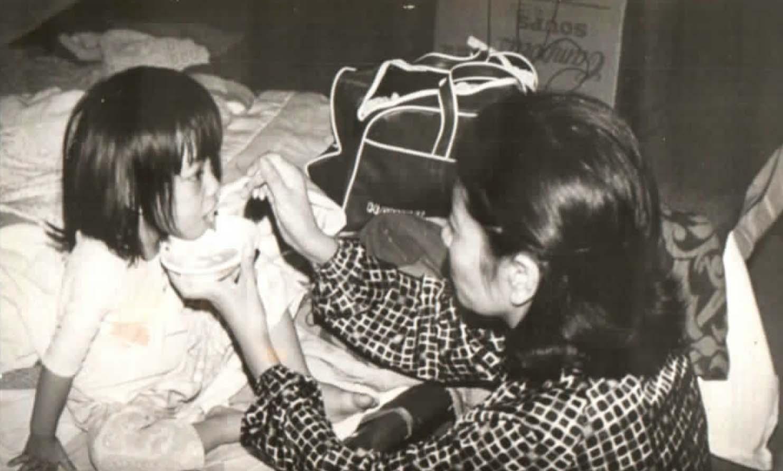Woman feeding child<br />