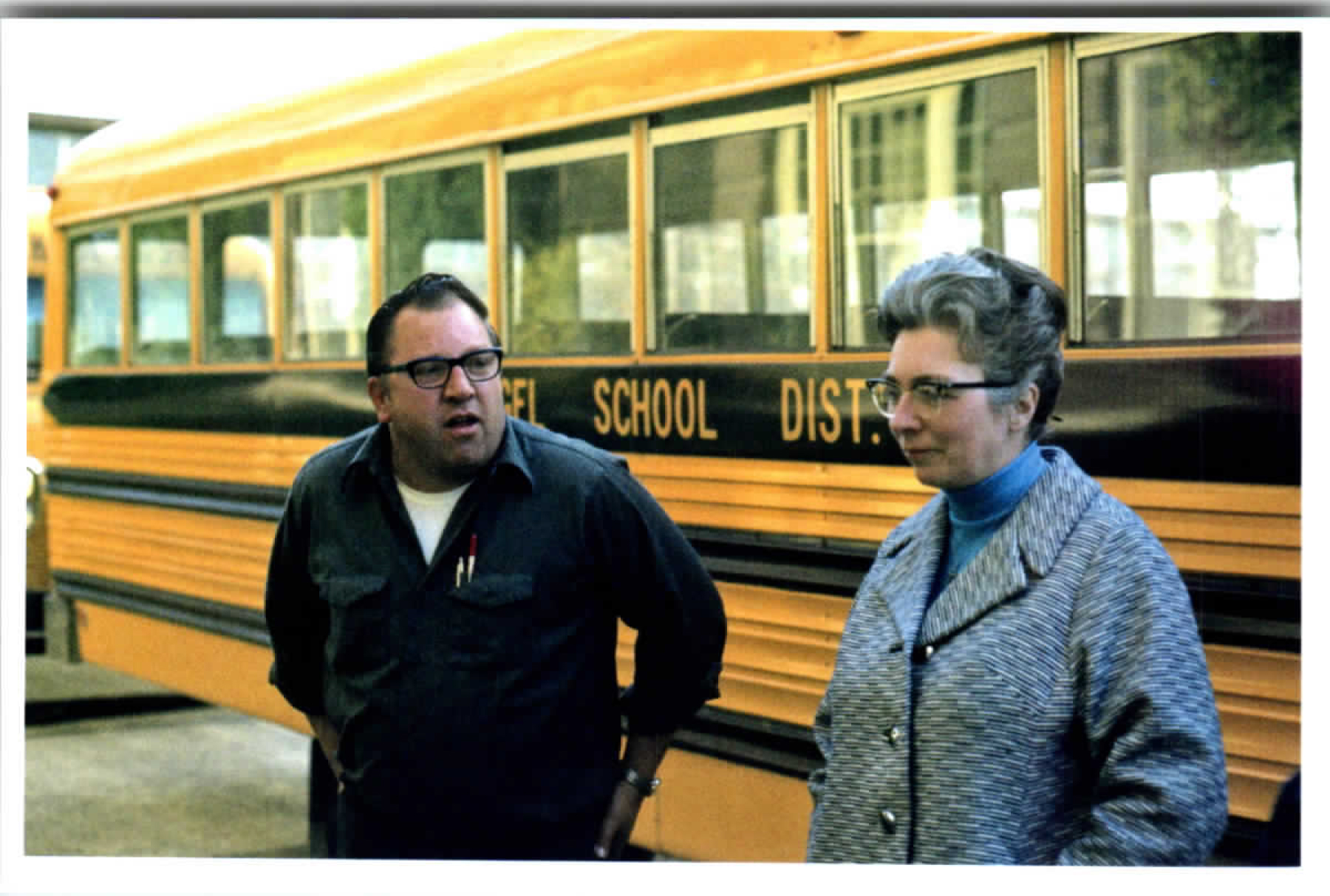 """""""April 23, 1975 -- Buses in front of the monastery -- taking volunteers to the airport to pick up Vietnamese refugees. Ed Jenck and Sr. Antoinette Traeger, prioress"""""""