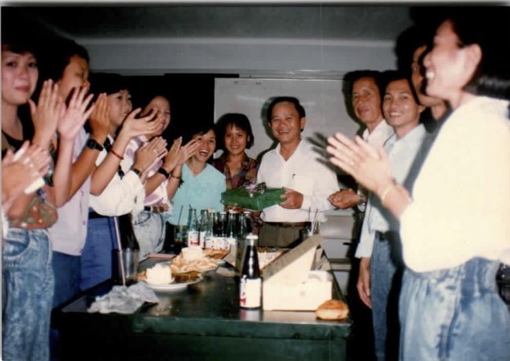 Photo of William Vuong and students celebrating